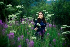 Woman in a blue blouse in a forest glade royalty free stock photos