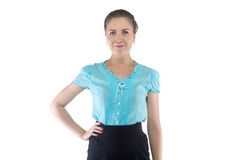Woman in blue blouse with hand on hip Stock Photos