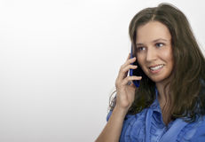 Woman in blue with a blue mobile Stock Images