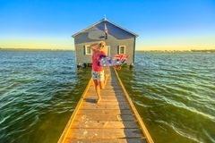 Woman at Blue Boat House royalty free stock image