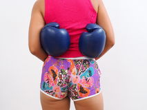 Woman with blue boxing gloves around her waistline. Rear view of attractive woman wearing shorts with blue boxing gloves around her waistline Stock Photos
