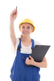 Woman in blue builder uniform with clipboard writing something i Royalty Free Stock Photo