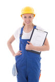 Woman in blue builder uniform holding clipboard with building sc Royalty Free Stock Image