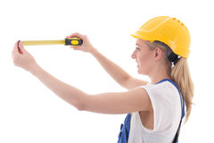 Woman in blue builder uniform holding measure tape isolated on w Stock Photos