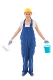Woman in blue builder uniform with paint brush and bucket isolat Royalty Free Stock Images