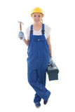 Woman in blue builder uniform with toolbox and hammer isolated o. N white background Royalty Free Stock Photo