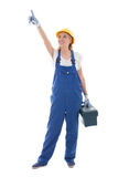 Woman in blue builder uniform with toolbox pointing at something. Isolated on white background Stock Photo