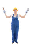 Woman in blue builder uniform with trowel and hammer isolated on Royalty Free Stock Photo