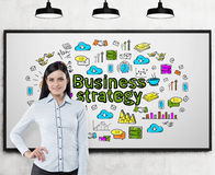 Woman in blue and business strategy Royalty Free Stock Images