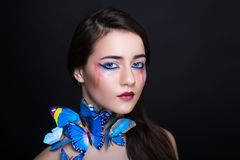 Woman blue butterfly Stock Images