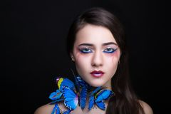 Woman blue butterfly stock image