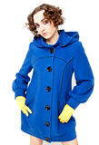 Woman in blue coat posing Royalty Free Stock Photos