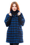 Woman in blue coat Stock Images