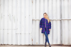 Woman  in a blue coat Royalty Free Stock Photography