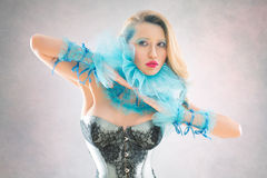 Woman in blue collar and corset Stock Photo