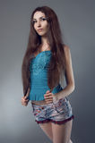 Woman in blue corset and shorts. Woman in blue corset and jeans shorts Royalty Free Stock Image