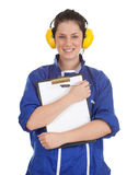 Woman in blue coveralls with blank clipboard Stock Photo