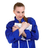 Woman in blue coveralls with map Stock Image