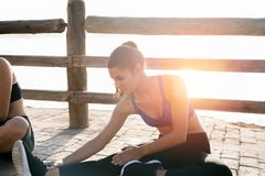 Woman in blue crop top doing stretching excersises Royalty Free Stock Photography