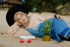 Woman in Blue Denim Dungaree Lying on Sand royalty free stock image