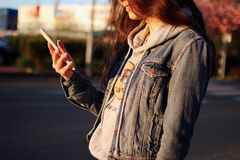 Woman in Blue Denim Jacket Daytime Photography Stock Photo
