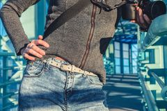 Woman in blue denim jeans. View of body without face stock image