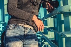 Woman in blue denim jeans. View of body without face stock photography