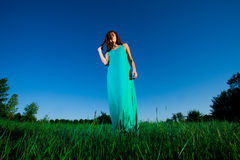Woman in blue dress Stock Photo