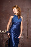 Woman in a blue dress Stock Photo