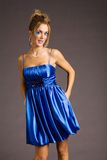 Woman in blue dress. Woman in fashionable blue mini dress Stock Photo