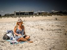 Woman In Blue Dress At The Beach Royalty Free Stock Photo