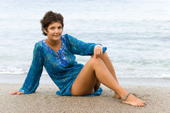Woman in blue dress on the beach Stock Photos