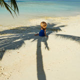 Woman in blue dress on a beach at Maldives Stock Images