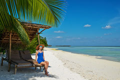Woman in blue dress on a beach at Maldives Royalty Free Stock Image