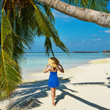 Woman in blue dress on a beach at Maldives Stock Photography