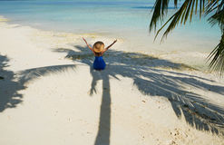 Woman in blue dress on a beach at Maldives Stock Photo