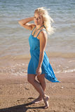 Woman blue dress beach serious Royalty Free Stock Image