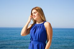 Woman in blue dress. Blond woman in the blue dress at the beach in Cyprus Stock Images