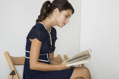 Woman In Blue Dress With Book Stock Photos