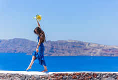 Woman in the blue dress dancing in  the sea Stock Photos