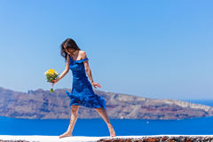 Woman in the blue dress dancing in  the sea Stock Photography