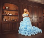 Woman in blue dress with gift. Woman in blue dress with present gift Stock Image