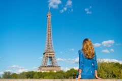 Woman in blue dress look at eiffel tower in paris, france, fashion. Woman with long hair, hairstyle, rear view, beauty. Fashion, s. Tyle, trend. Beauty, look Stock Photos
