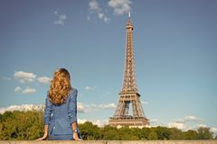 Woman in blue dress look at eiffel tower in paris, france, fashion. Woman with long hair, hairstyle, rear view, beauty. Fashion, style, trend. Beauty, look stock photography
