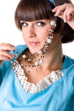 Woman in blue dress with pearl beads Stock Photos