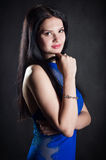 A woman in a blue dress Stock Photography