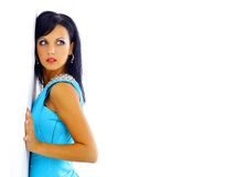 Woman in a blue dress posing. On a white background Stock Image