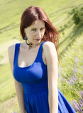 Woman in a blue dress posing. On rural landscape Stock Photography