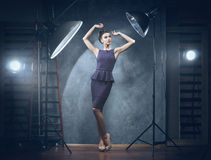 A woman in a blue dress posing in a studio Royalty Free Stock Image