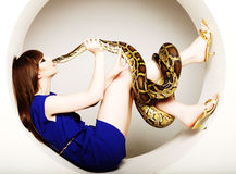 Woman in blue dress with Python Royalty Free Stock Photos